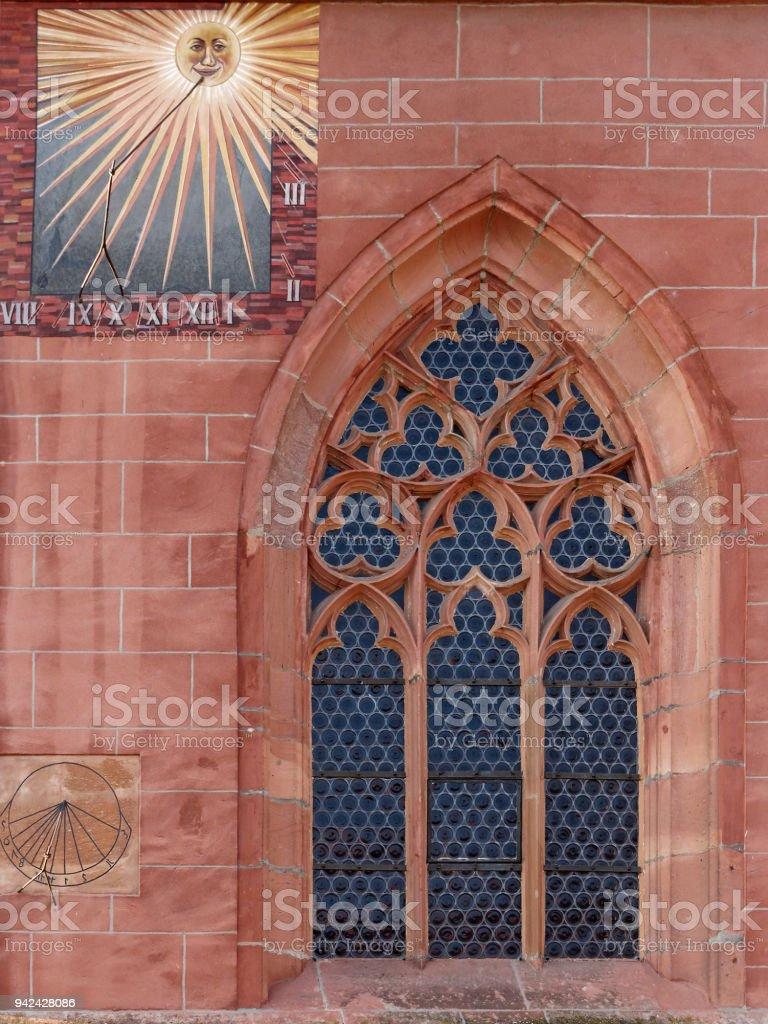 sundial with gothic church window stock photo