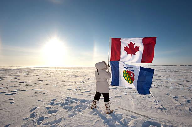Sundog or Parhelion in Canada's Arctic with Canadian Flag. stock photo