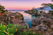This image depicts the colors of sunset at the bay of Avlemonas village in the island of Kythira, Greece
