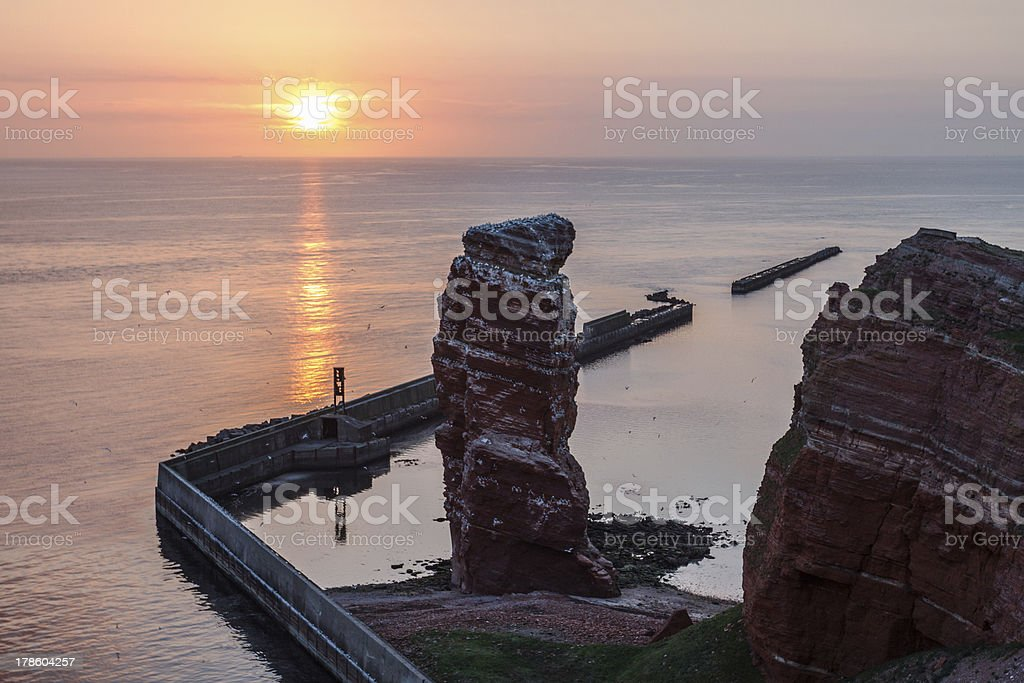 Sundown on Helgoland with Lange Anna and calm sea stock photo
