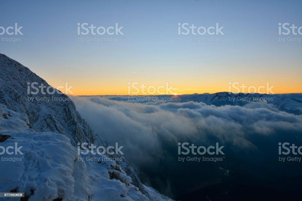 sundown over the mountains peak stock photo