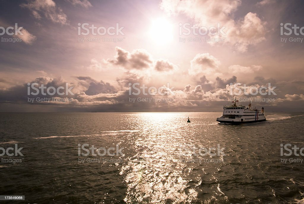 Sundown with a ferry royalty-free stock photo