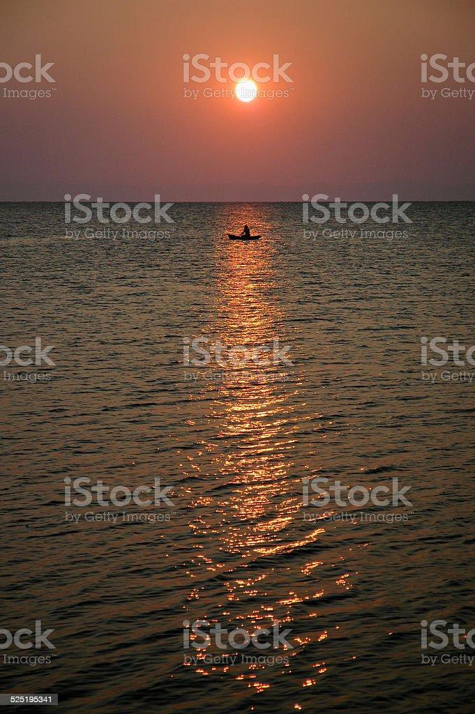 Sundown with canoe on Lake Malawi Africa stock photo