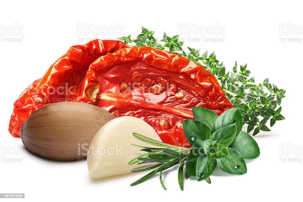 Sundried oiled tomatoes with herbs, paths stock photo