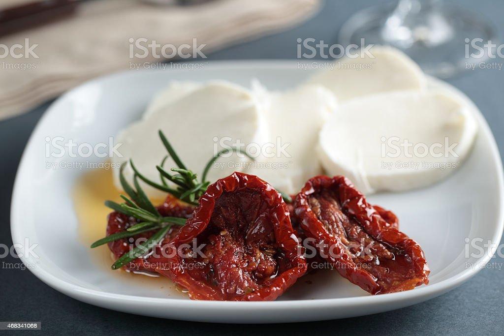 Sun-dried tomatoes and mozzarella stock photo