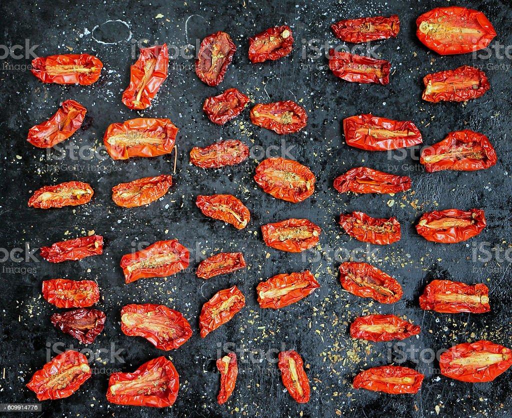 Sun-dried tomatoes on black. stock photo