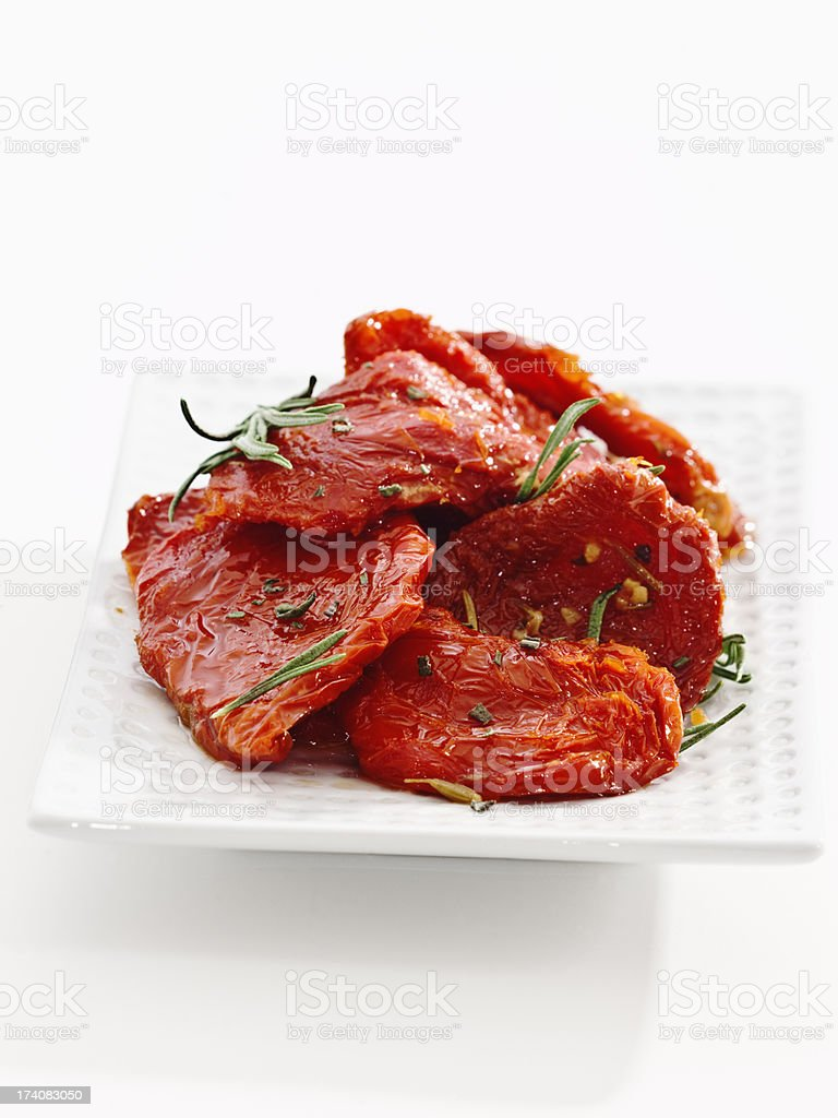sundried tomatoes with herbs stock photo