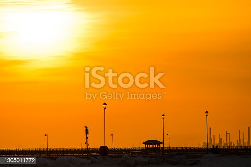 Sunset photographed from Ryde Beach on the Isle of Wight, with Ryde Pier and Fawley Power Station, Southampton in the background.