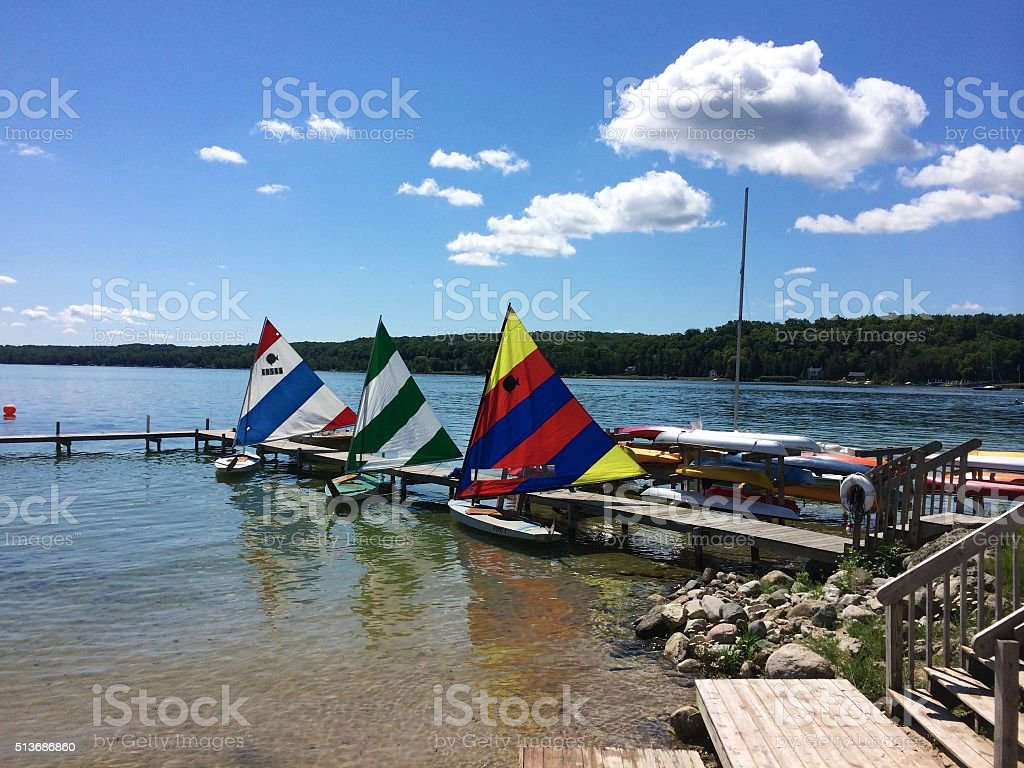 Sunfish Sailboats Tied to Dock stock photo