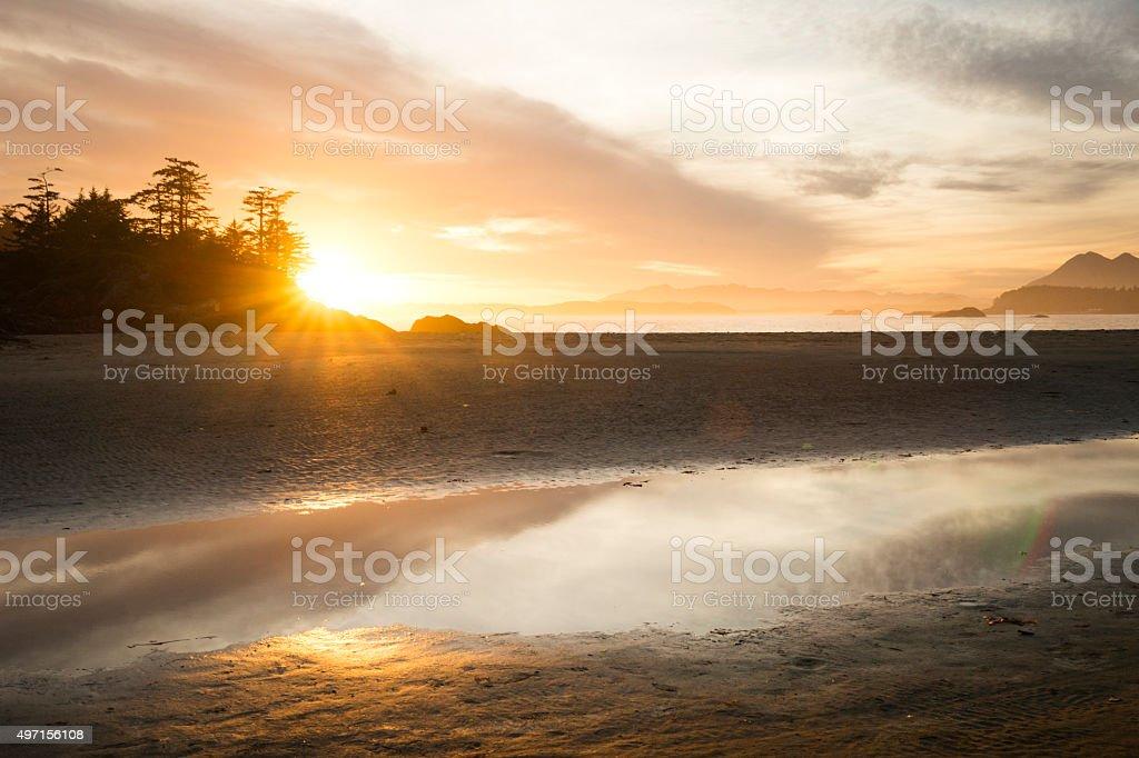 Sunflare sunset on Chesterman Beach, Tofino stock photo
