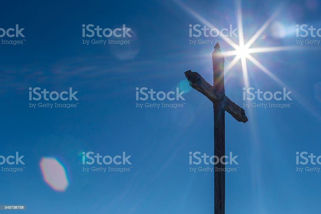 Sunflare with a cross stock photo
