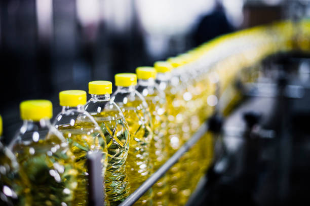 sunflower oil factory, close-up, high iso, selective focus - bottling plant stock photos and pictures