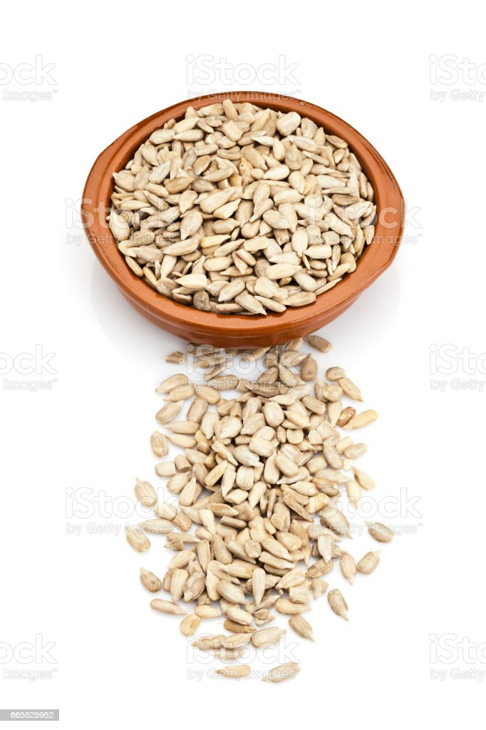 Sunflower seeds in a brown bowl stock photo