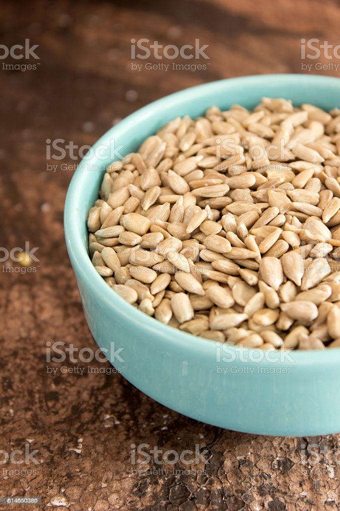 Sunflower Seeds in a Ceramic Bowl stock photo