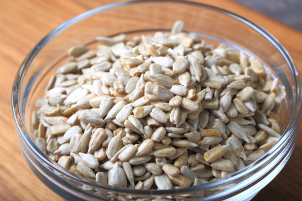 Sunflower seeds in a glass bowl stock photo