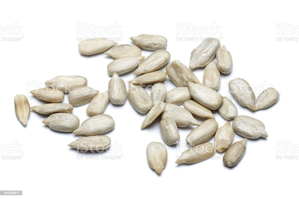 Sunflower seeds in white background stock photo