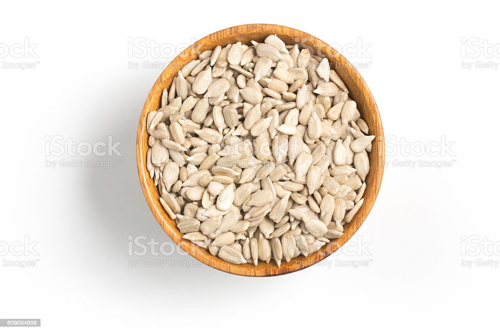 Sunflower Seeds into a bowl stock photo
