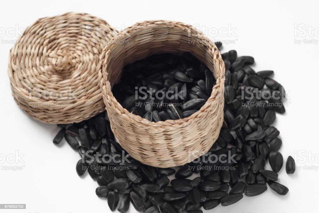 Sunflower seeds scattered on a white background, royalty-free stock photo