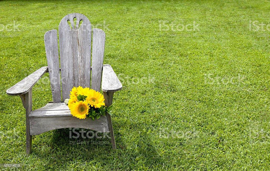 Sunflowers on Adirondack Chair royalty-free stock photo