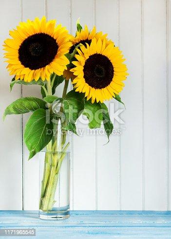 Sunflowers on wood