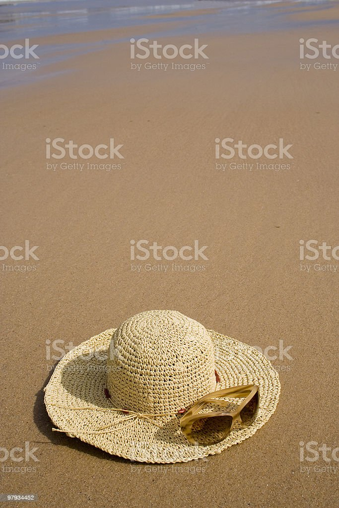 sunglass and a summer hat royalty-free stock photo