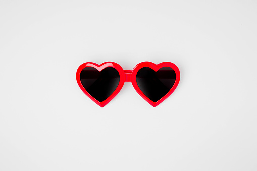 Sunglass in the shape of a heart on a white background