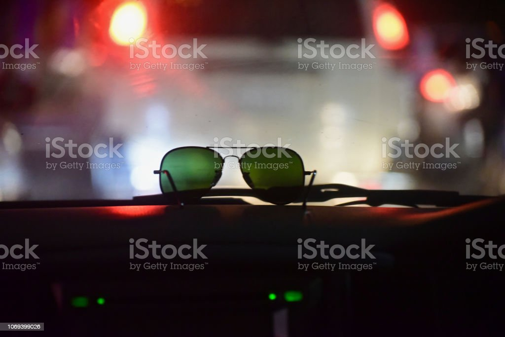 A sunglass kept on top of a cars dashboard unique photo