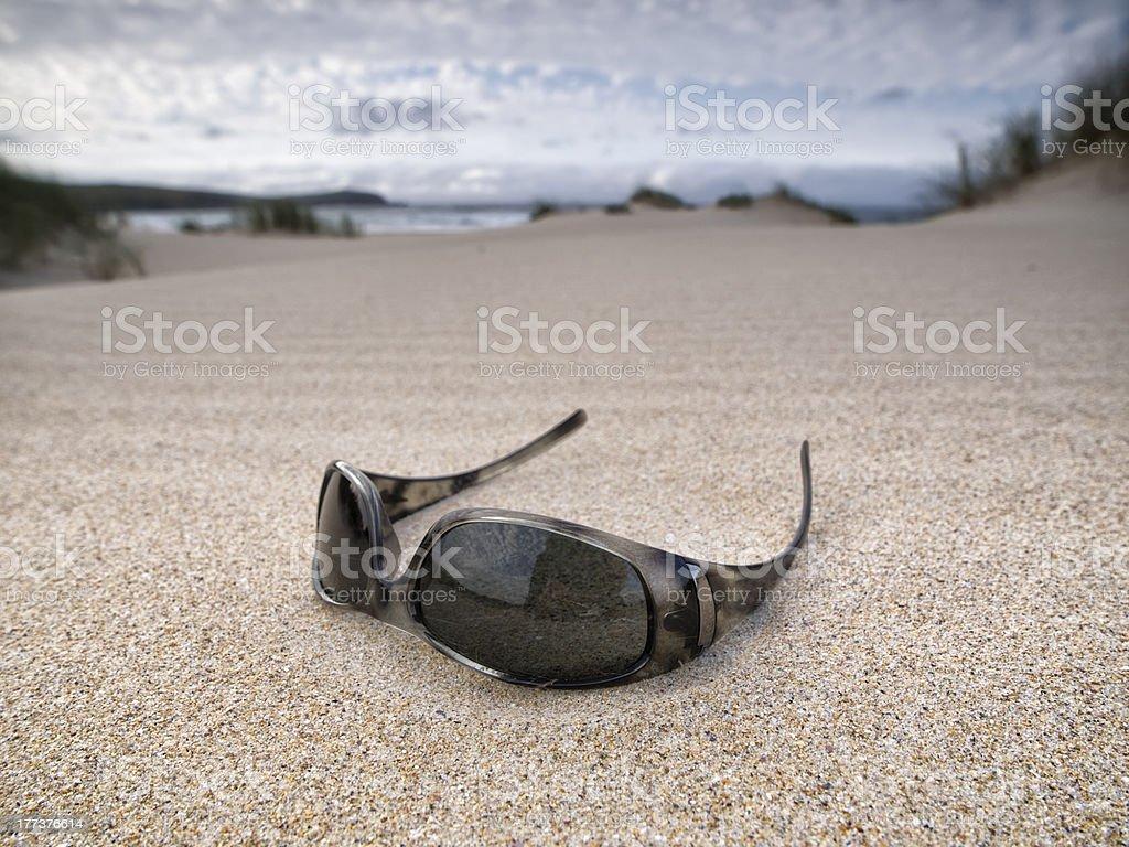 Sunglasses abandoned on the beach stock photo