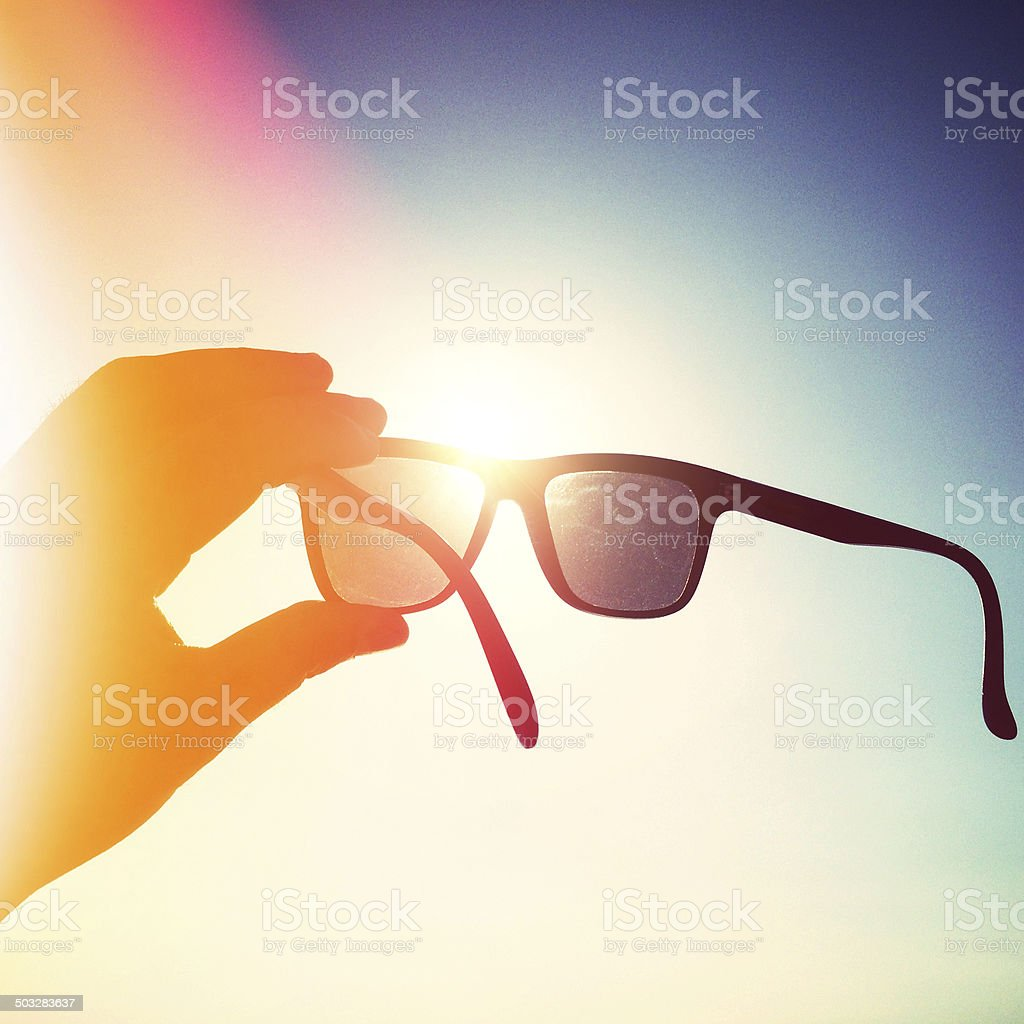 sunglasses against sunlight on summer stock photo