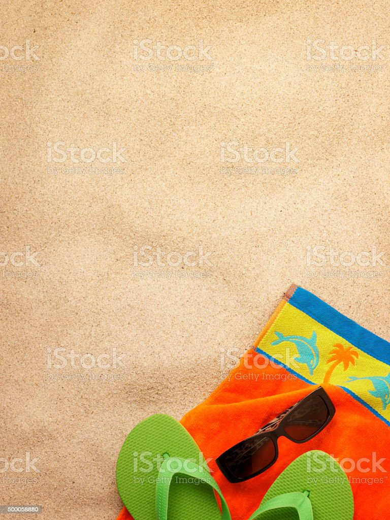Sunglasses And A Beach Towel Lying On The Sand stock photo