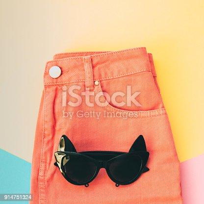 640200626istockphoto sunglasses and denim skirt. 914751324