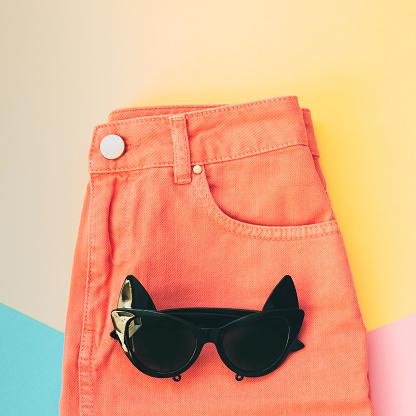 640200626 istock photo sunglasses and denim skirt. 914751324