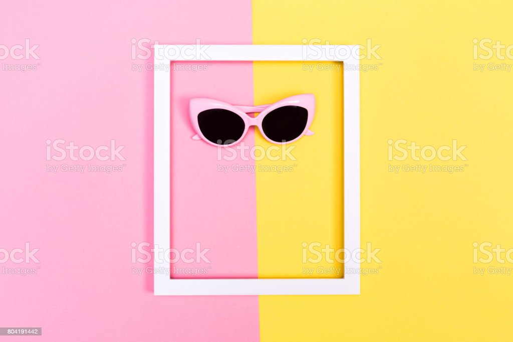 Sunglasses and frame on split background stock photo