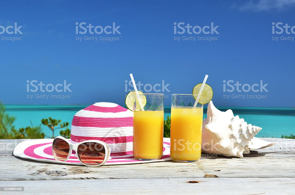 Sunglasses and orange juice stock photo