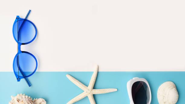 Sunglasses and starfish and seashell – zdjęcie