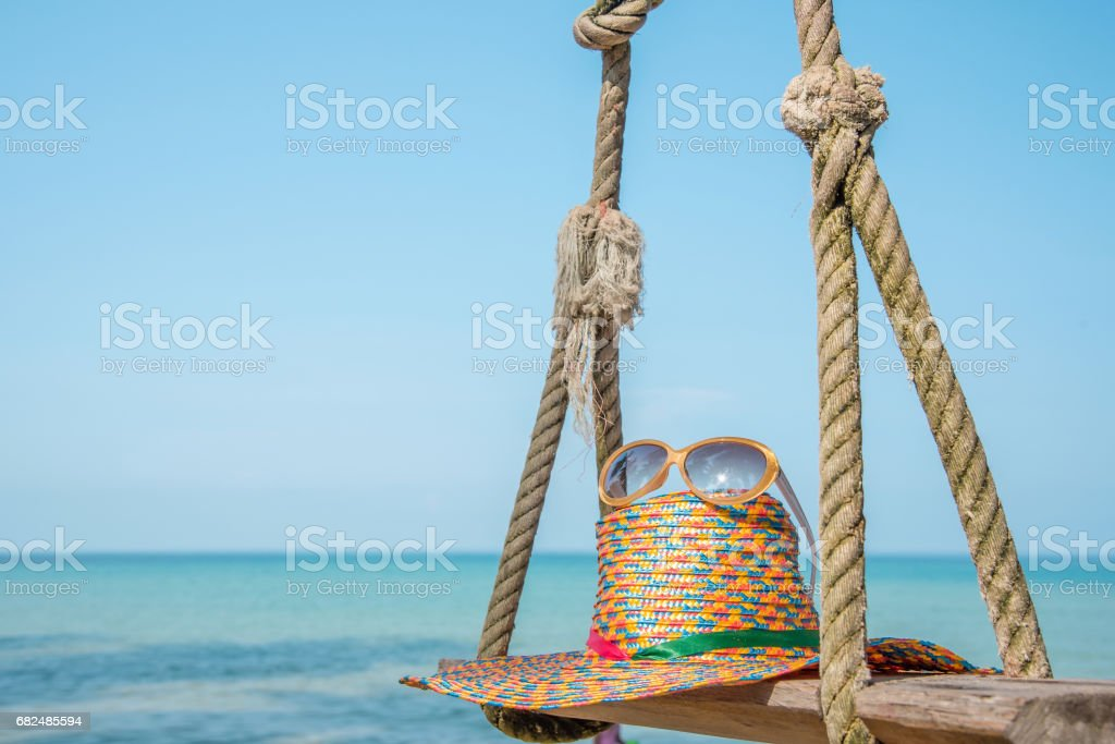 sunglasses and straw hat with blur blue sea and sky background royalty-free stock photo