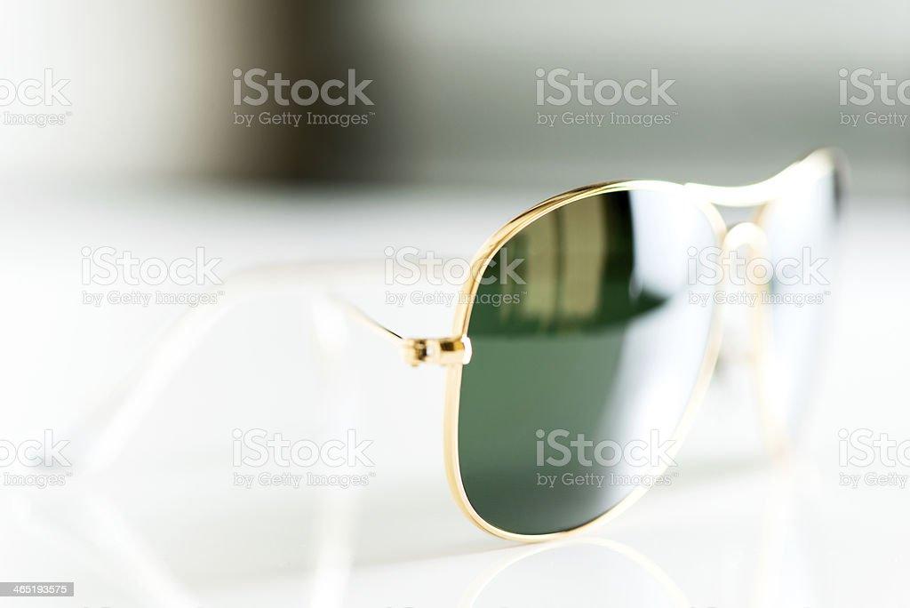 Sunglasses artistic composition macro stock photo