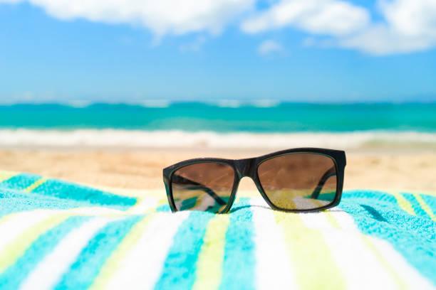 Sunglasses at the beach stock photo