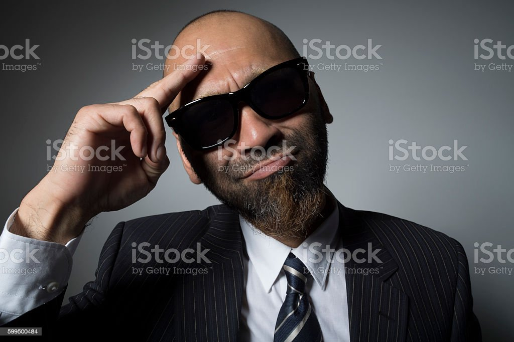 Sunglasses businessman is healthy today. stock photo