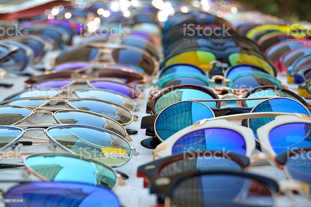 Sunglasses displayed on market table stock photo