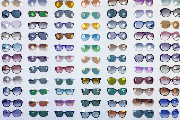 sunglasses in store - sale lenses stock photos and pictures