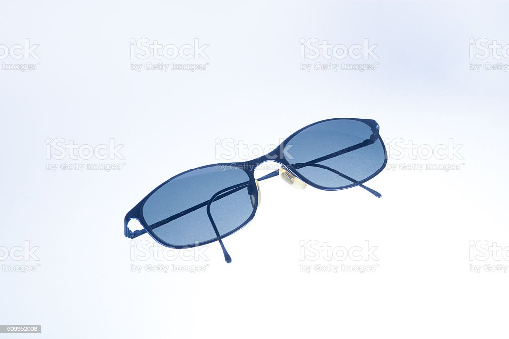 sunglasses in the foreground stock photo