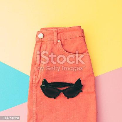 640200626istockphoto sunglasses in the shape of cat on denim skirt 914751320