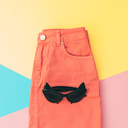 640200626 istock photo sunglasses in the shape of cat on denim skirt 914751320