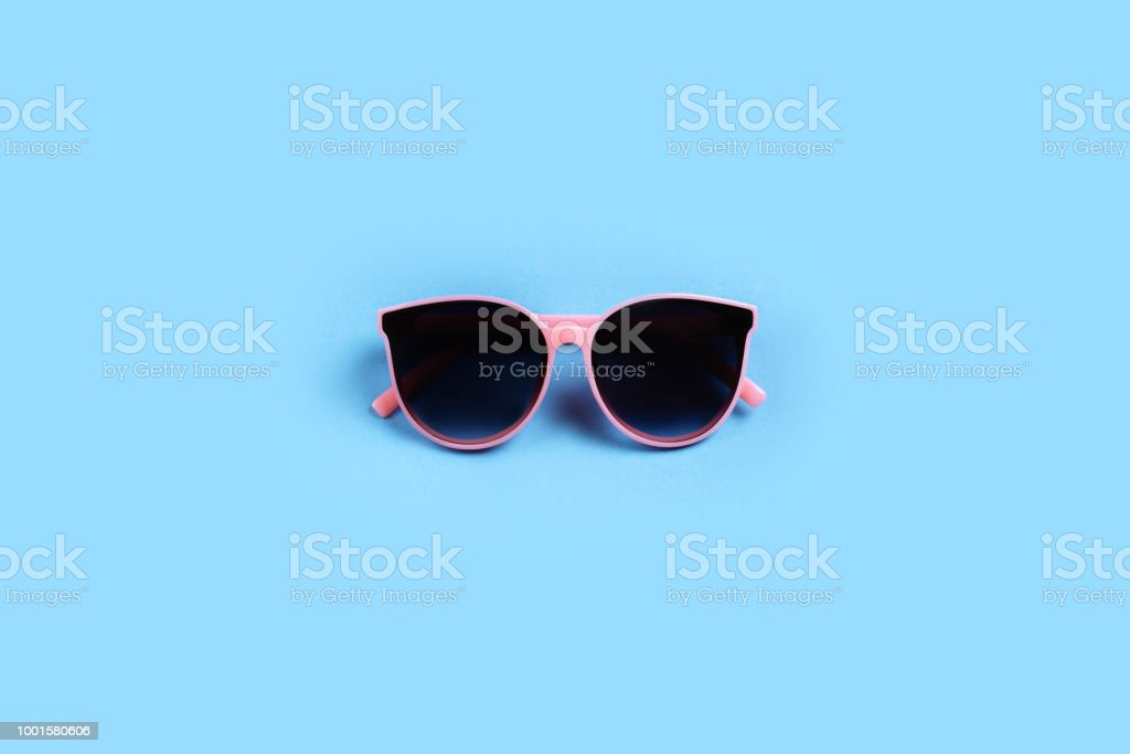 sunglasses isolated on a pink background stock photo