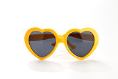 yellow heart-shaped sunglasses isolated on white