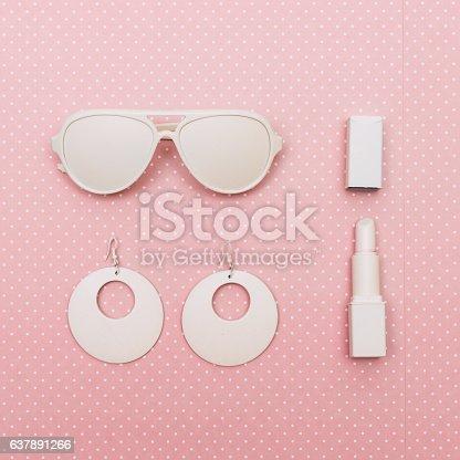640200626istockphoto sunglasses, lipstick and earrings 637891266