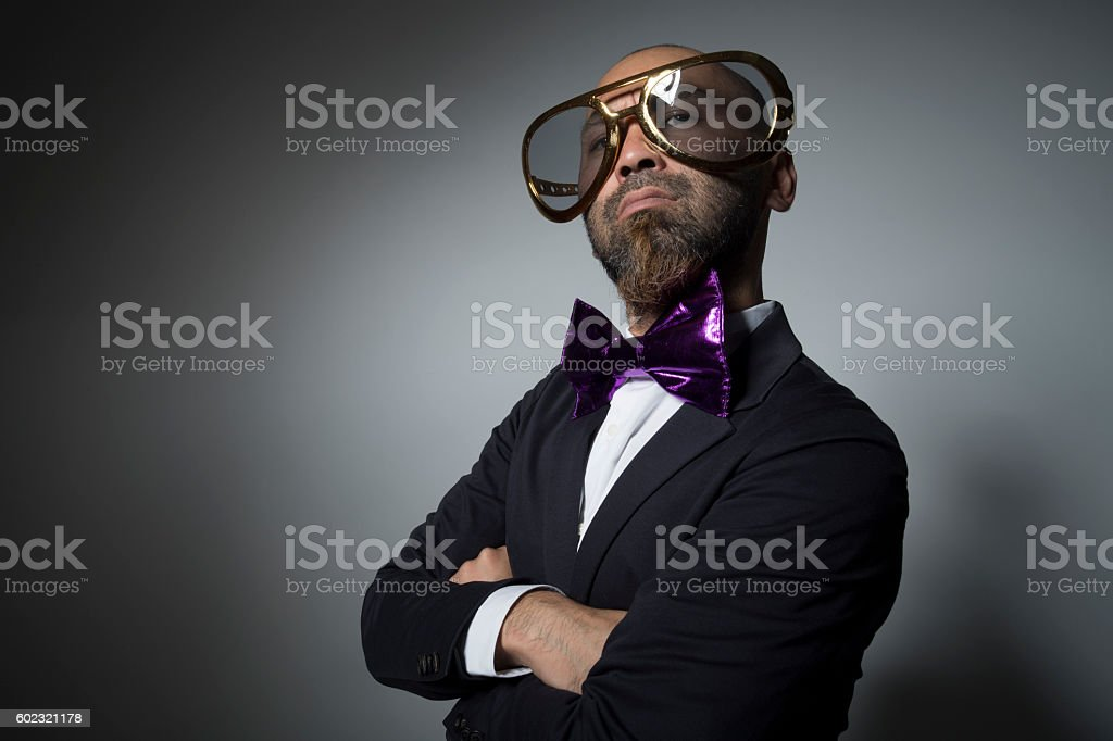 Sunglasses man is a serious face. stock photo