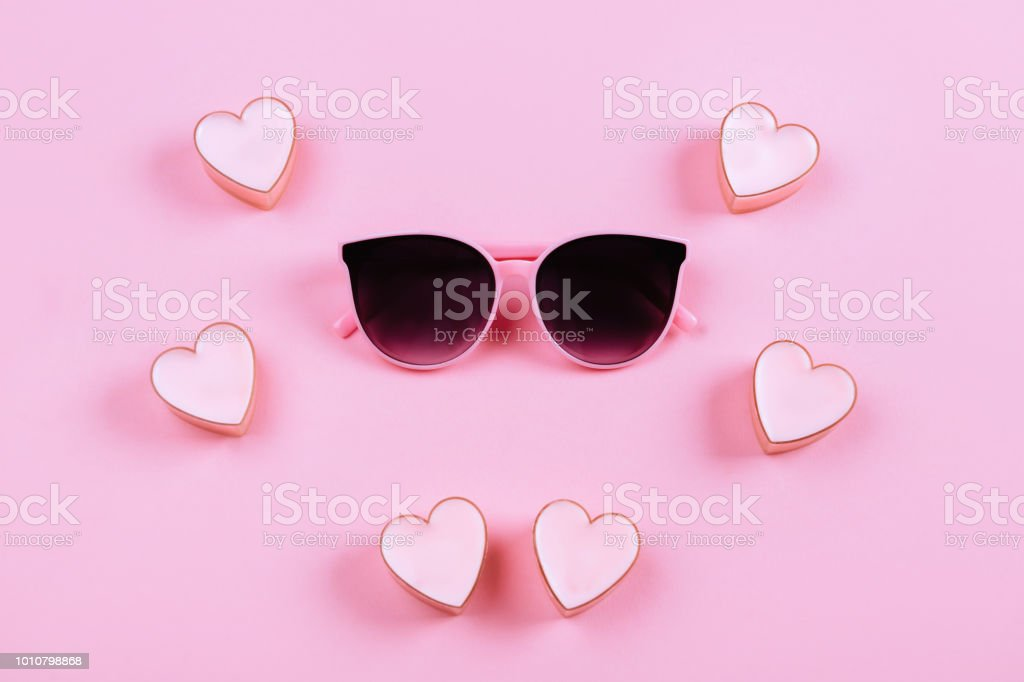 sunglasses on a pink background stock photo