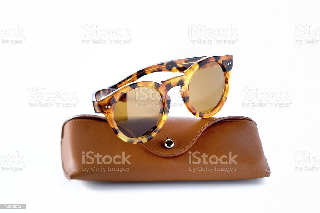 sunglasses on leather spectacle case royalty-free stock photo